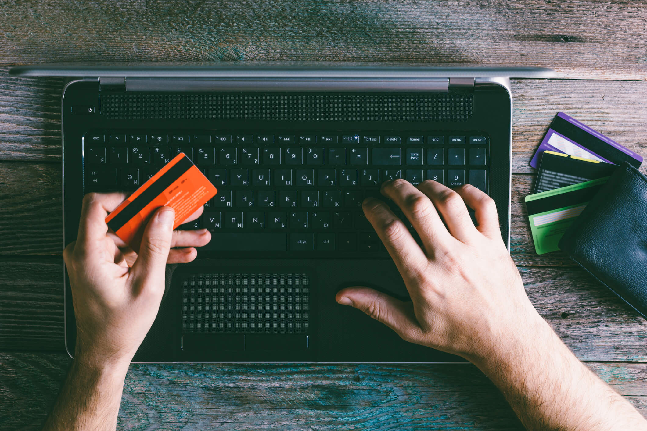 Man Hands holding credit card and using laptop